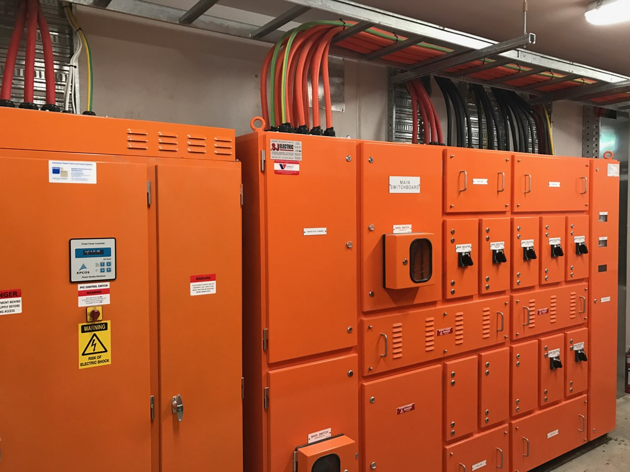 Orange switchboards Vast Electrical